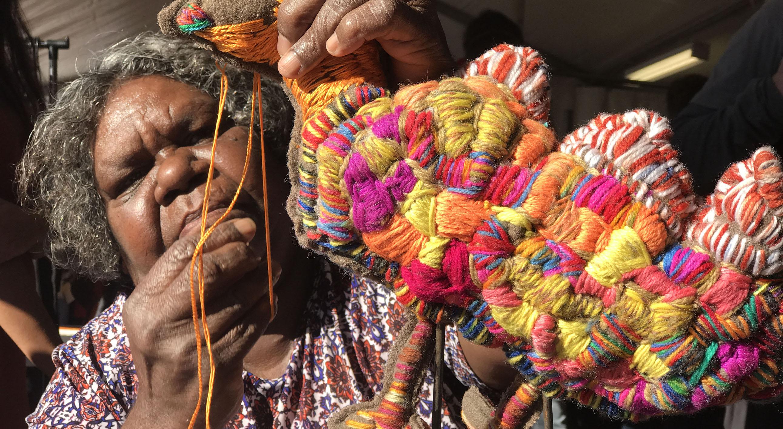 Photo is of artist Marlene Rubuntja from Yarrenyty Arltere Artists (Alice Springs, NT). Photographer,  Lyndsay Urquhart.