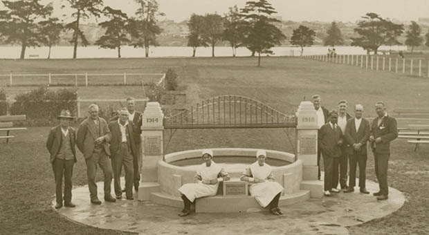 Douglas Grant, nurses and ex-servicemen gather around the war memorial built by Grant at Callan Park, which featured an ornamental pond and a replica of the Sydney Harbour Bridge, 1931 (Photograph courtesy State Library of NSW, Digital Order number a368022)