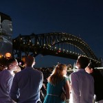 A group of friends watch the Welcome to Country ceremony near the Sydney Harbour Bridge during the New Year's Eve 2015 celebrations (photograph by Cole Bennetts, courtesy City of Sydney/Getty Images)