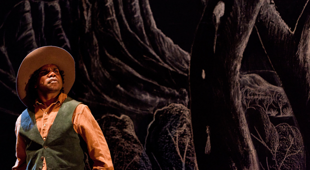 Actor Derek Lynch in a production of Namatjira at the Belvoir St Theatre in 2010 (photography by Brett Boardman, courtesy Belvoir St Theatre)